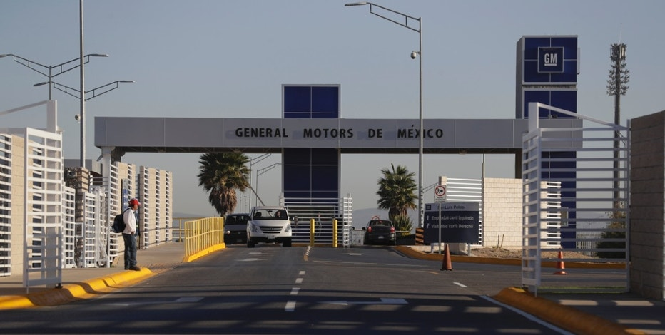 Cars exit the General Motors assembly plant in Villa de Reyes, outside San Luis Potosi, Mexico, Wednesday, Jan. 4, 2017, where the Aveo and Trax vehicles have been produced since 2008. President-elect Donald Trump sent tweets this week threatening to impose heavy tariffs on GM and Toyota cars produced in Mexico for the U.S. market. (AP Photo/Rebecca Blackwell)