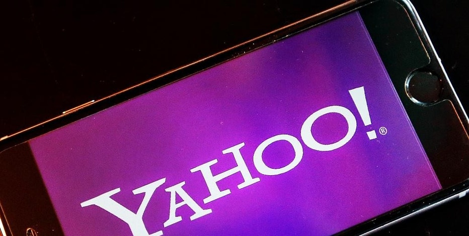 FILE - In this Dec. 15, 2016, file photo, the logo of Yahoo appears on a smartphone in Frankfurt, Germany. Yahoo Inc. reports quarterly financial results after the market closes, Monday, Jan. 23, 2017. (AP Photo/Michael Probst, File)