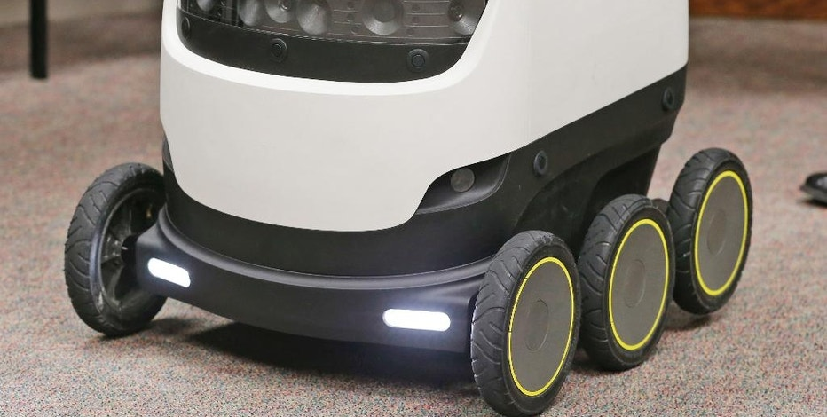 The Starship Technologies delivery robot goes through it's paces during a demonstration at the Capitol in Richmond, Va., Wednesday, Jan. 25, 2017. State lawmakers have partnered with European company Starship Technologies on bills that would allow Virginia cities to join two others in the U.S. and many across Europe where the company is testing the robots. Much like big-time retailers' attempts at drone deliveries, the robots aim to revolutionize the way people get their parcels. (AP Photo/Steve Helber)