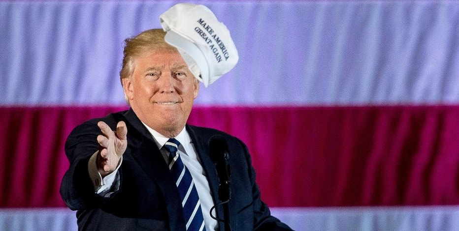 "FILE - In this Friday, Dec. 9, 2016, file photo, President-elect Donald Trump throws a hat into the audience while speaking at a rally in a DOW Chemical Hanger at Baton Rouge Metropolitan Airport, in Baton Rouge, La. ""America First"" is President Donald Trump's economic policy. Investors shouldn't follow suit, fund managers say. Even though foreign stocks have been mired in their own lost decade and have woefully fallen short of the U.S. stock market's return, many fund managers say they see bigger returns ahead from foreign stocks because they're not as expensive as their U.S. counterparts. (AP Photo/Andrew Harnik, File)"