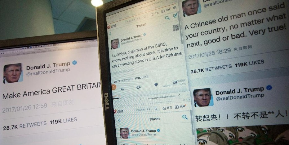 Computer screens display the fake tweets that online users can self generate at a Chinese website in Beijing, China, Thursday, Jan. 26, 2017. Online users are flocking to a new Chinese website that lets them generate images of fake tweets that look just like those sent by President Donald Trump's distinctive personal Twitter account_ replete with his avatar and a real-time timestamp. (AP Photo/Ng Han Guan)