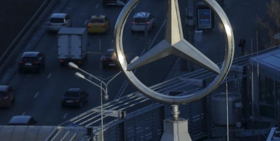 The logo of Daimler's Mercedes-Benz luxury-car division is pictured on the roof of a building in Moscow, Russia, April 5, 2016. REUTERS/Maxim Shemetov/File Photo