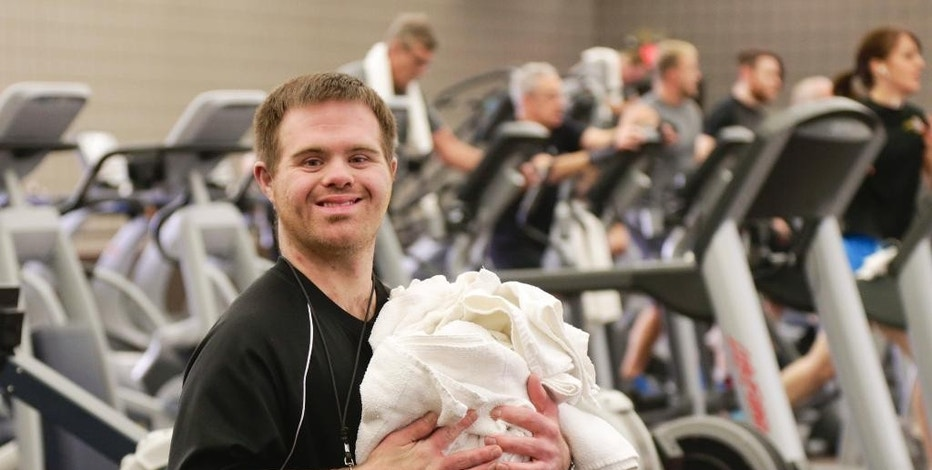 In this Wednesday, Jan. 25, 2017, photo, Justin Bainbridge poses for a picture where he works at the Prairie Life Fitness Center in Omaha, Neb. Bainbridge works two part-time jobs: folding towels at the gym and taking tickets at a movie theater, but he wasn't allowed to start saving money for his future until a few months earlier. A new type of savings program is giving Bainbridge and others with disabilities, a chance to save more cash. (AP Photo/Nati Harnik)