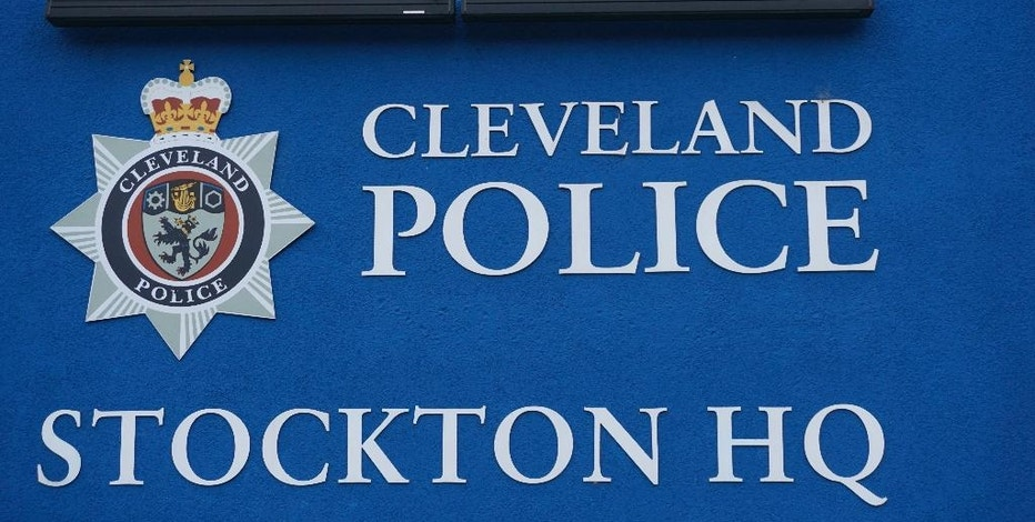 In this photo dated Friday, Jan. 13, 2017, the blue sign of Cleveland Police station is seen in Stockton-on-Tees, England. Stories in the local Northern Echo newspaper about racism in the local police force, prompted police to spy on journalists over the past 5-years, according to court documents, although Cleveland Police issued a statement to deny allegations. (AP Photo/Raphael Satter)