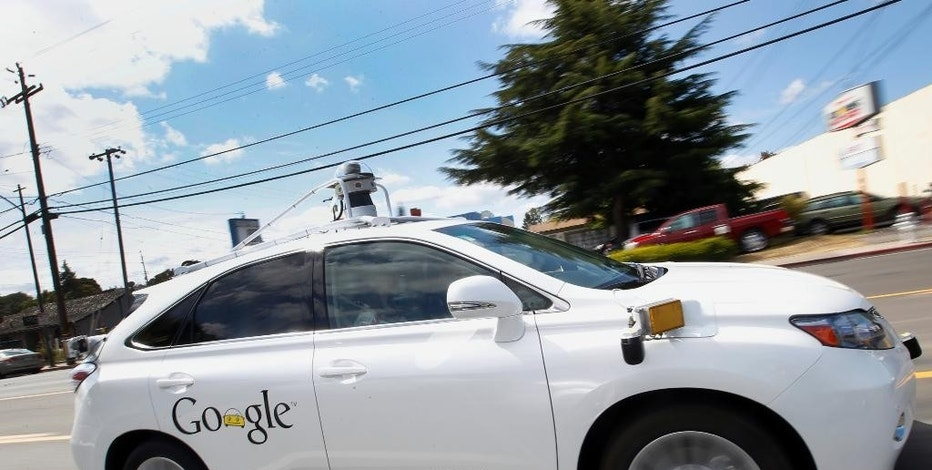 "FILE - In this May 13, 2015, file photo, Google's self-driving Lexus car drives along street during a demonstration at Google campus in Mountain View, Calif. California regulators release safety reports filed by 11 companies that have been testing self-driving car prototypes on public roads on Wednesday, Feb. 1, 2017. The papers report the number of times in 2016 that human backup drivers took control from the cars' self-driving software, though companies argue such ""disengagements"" don't always reflect something going wrong. (AP Photo/Tony Avelar, File)"