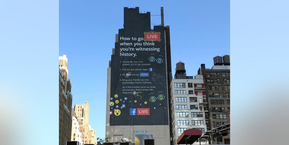This Nov. 16, 2016, photo shows a Facebook Live billboard on the side of a building near New York's Penn Station. From billboards to TV ads to endless notifications, Facebook is furiously promoting its live video feature as it tries to get more users to shoot and watch such videos. (AP Photo/Anick Jesdanun)
