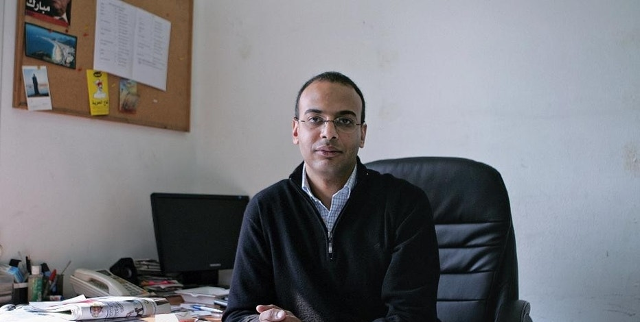 FILE -- This Dec. 7, 2011 photo, shows Hossam Bahgat in his office at the Egyptian Initiative for Personal Rights in Garden City, Cairo, Egypt. Egyptian human rights organizations have been under intense pressure at home, targeted with arrests, asset freezes, travel bans and grinding government investigation. But a report published Thursday, Feb. 2, 2017, by Citizen Lab, a prominent internet watchdog, said the groups are also under pressure online, targeted by volleys of malicious emails clearly aimed at compromising the data of the groups involved. (Sarah Rafea via AP, File) MANDATORY CREDIT