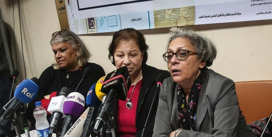 FILE - In this Feb. 21, 2016 file photo, Aida Seif el-Dawla, Suzan Fayyad, center, and Magda Adly, right, co-founder of El Nadeem Center for Rehabilitation of Victims of Violence, hold a press conference in Cairo. Egyptian human rights organizations have been under intense pressure at home, targeted with arrests, asset freezes, travel bans and grinding government investigation. But a report published Thursday, Feb. 2, 2017, by Citizen Lab, a prominent internet watchdog, said the groups are also under pressure online, targeted by volleys of malicious emails clearly aimed at compromising the data of the groups involved. (AP Photo/Mohamed el Raai, File)