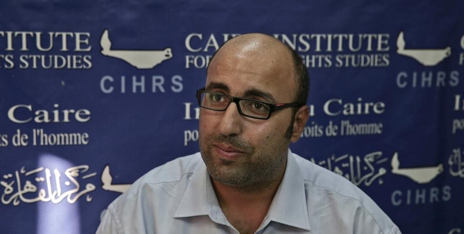 FILE --In this Sept. 30, 2014 file photo, Mohammed Zaree, the Egyptian Program Manager for the Cairo Institute for Human Rights Studies, speaks during an interview with The Associated Press at his office in Cairo, Egypt. Egyptian human rights organizations have been under intense pressure at home, targeted with arrests, asset freezes, travel bans and grinding government investigation. But a report published Thursday, Feb. 2, 2017, by Citizen Lab, a prominent internet watchdog, said the groups are also under pressure online, targeted by volleys of malicious emails clearly aimed at compromising the data of the groups involved. (AP Photo/Nariman El-Mofty, File)