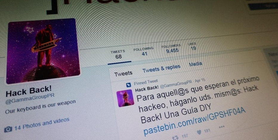 In this Tuesday, Jan. 31, 2017 photo,  a computer screen shows an archived copy of the Twitter feed belonging to Phineas Fisher, a hacker who claimed responsibility for breaching the union of the Mossos d'Esquadra, Catalonia's regional police, last year. Spanish police have arrested three people over a data breach linked to a series of dramatic intrusions at European spy software companies — feeding speculation that the net has closed on an online Robin Hood figure known as Phineas Fisher. (AP Photo/Raphael Satter)