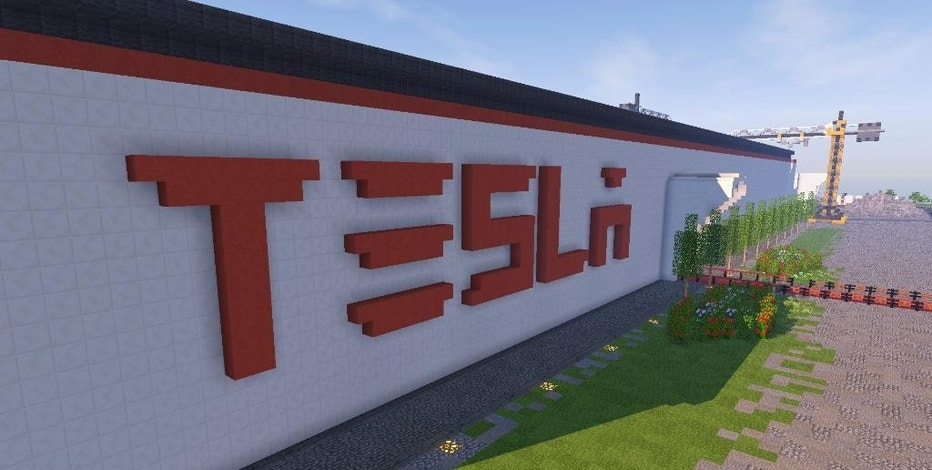 "In this undated photo received on Saturday, Feb. 4, 2017 taken by Darius Kniuksta, a scene from a video game featuring a Tesla gigafactory.  Lithuanians badly want Tesla Motors to build its next giant factory on their soil, so to grab the attention of the California tech company they built a virtual version of a facility inside the ""Minecraft"" video game. Vladas Lasas, who was behind the project, says they wanted to send a message to Tesla CEO Elon Musk that Lithuania ""has plenty of skillful"" people as well as a perfect factory site. (Darius Kniuksta via AP)"