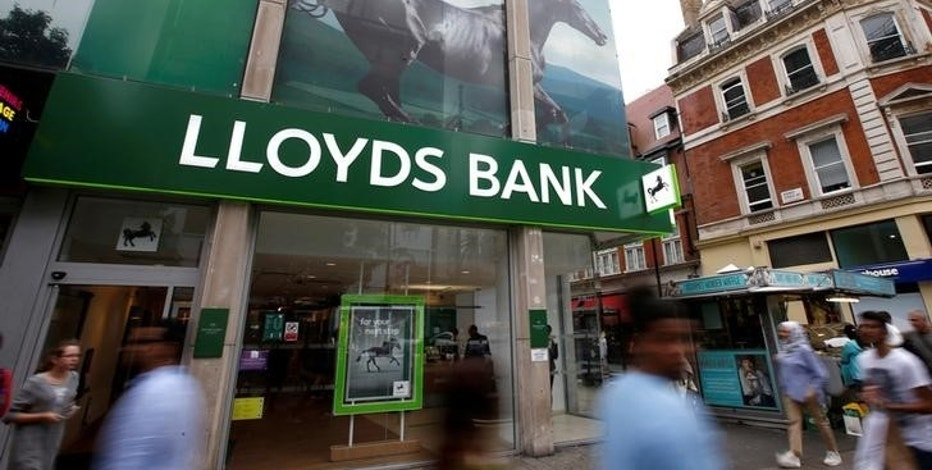 FILE PHOTO: People walk past a branch of Lloyds Bank on Oxford Street in London, Britain July 28, 2016.  REUTERS/Peter Nicholls/File Photo