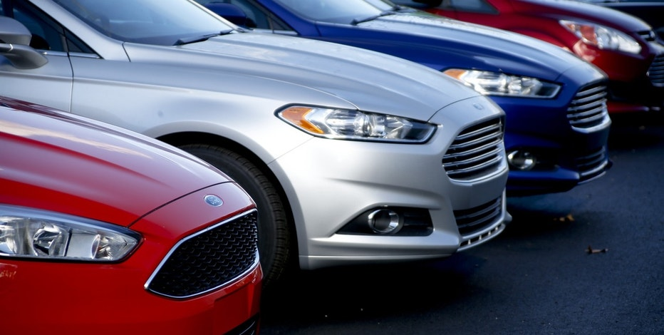 In this Thursday, Nov. 19, 2015, file photo, a row of new Ford Fusions are for sale on the lot at Butler County Ford in Butler, Pa. Ford Motor Co. has built the midsize Fusion sedan at its plant in Hermosillo, Mexico, since its introduction in 2005.