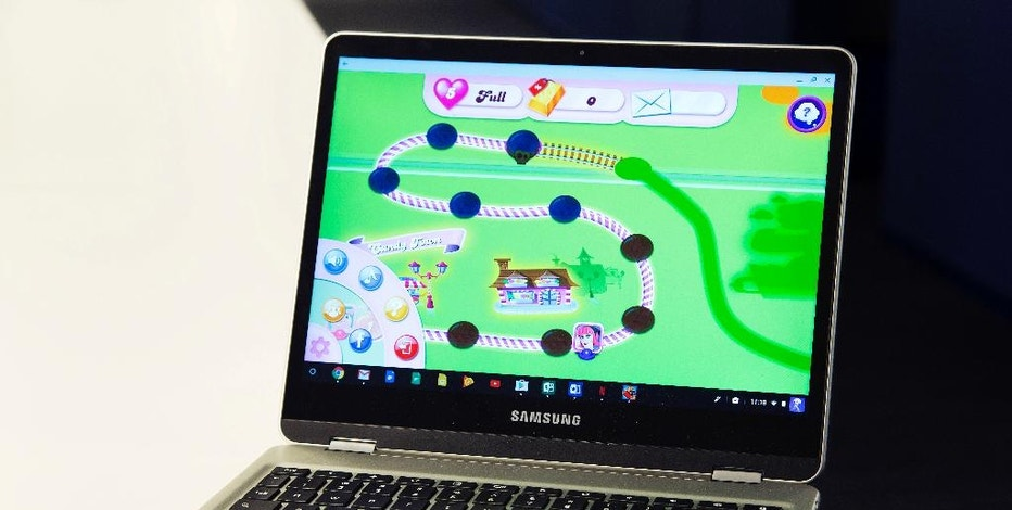 In this Feb. 8, 2017, photo, a Google Chromebook displays Candy Crush Saga in New York. Google Chromebook laptops are impractical for many people because they're little more than expensive paperweights when they're out of range of an internet connection. Yet they've defied expectations and made tremendous inroads in one of the least likely places: U.S. schools. (AP Photo/Mark Lennihan)
