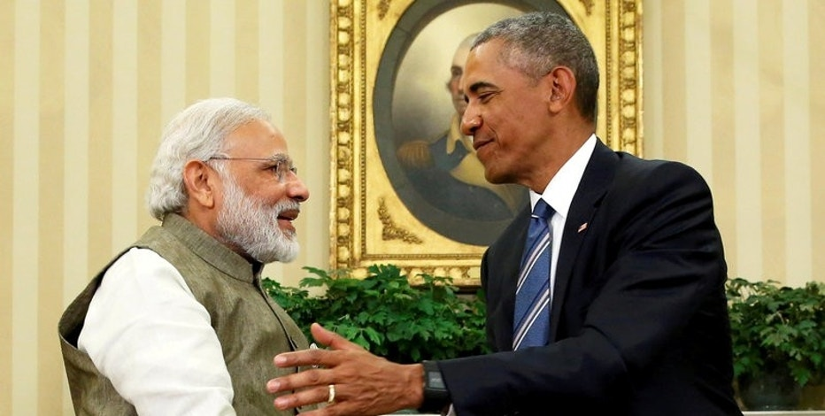 FILE PHOTO: U.S. President Barack Obama (R) shakes hands with India's Prime Minister Narendra Modi after their remarks to reporters following a meeting in the Oval Office at the White House in Washington, June 7, 2016. REUTERS/Jonathan Ernst/File Photo