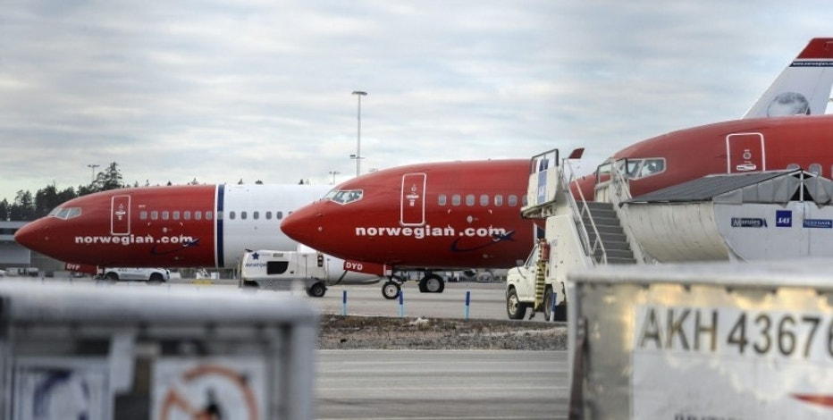 A view of parked aircrafts belonging to budget carrier Norwegian at Stockholm Arlanda Airport March 5, 2015.  REUTERS/Johan Nilsson/TT News Agency