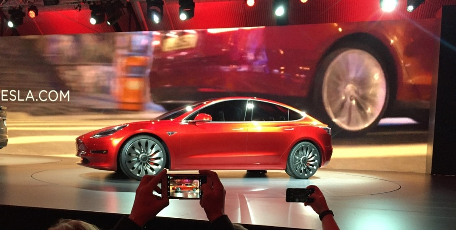 Tesla Motors unveils the new lower-priced Model 3 sedan at the Tesla Motors design studio Thursday, March 31, 2016, in Hawthorne, Calif.