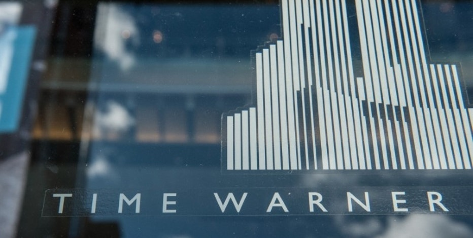 Signage that reads Time Warner is seen at the Time Warner Center in New York City, U.S. on October 23, 2016. REUTERS/Stephanie Keith/File Photo