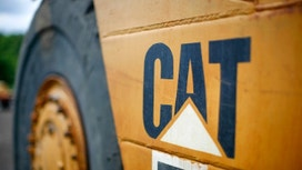 Caterpillar CEO Apologizes to Employees After Feds Raid Offices