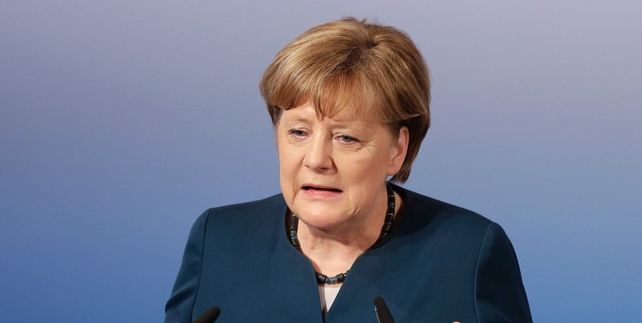 FILE - In this Feb. 18, 2017 file photo, German Chancellor Angela Merkel speaks in Munich, Germany. President Donald Trump will meet with Merkel at the White House later this month. A White House official says the meeting with take place on March 14. It will be the first in-person meeting between Trump and the German chancellor since the U.S. election.  (AP Photo/Matthias Schrader, File)