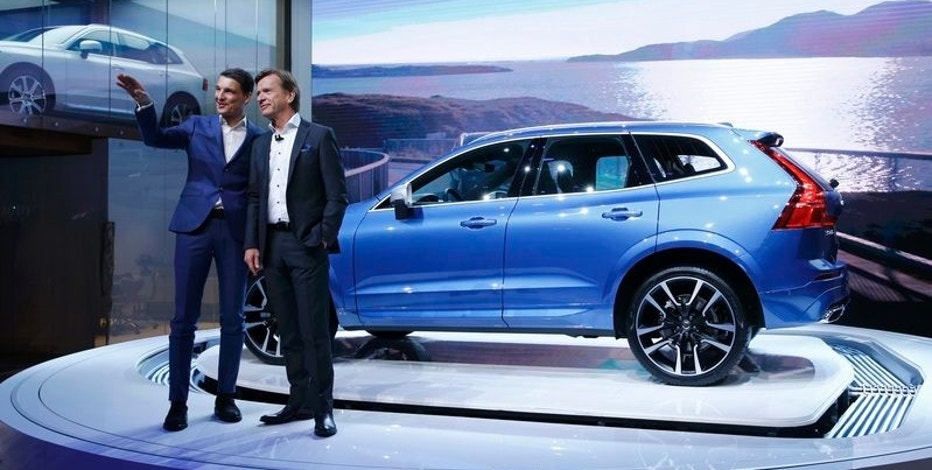 Vovlo CEO Hakan Samuelsson (R) and Senior Vice-President Design Thomas Ingenlath speak during presentation of the new Volvo XC60 car during the 87th International Motor Show at Palexpo in Geneva, Switzerland, March 7, 2017. REUTERS/Denis Balibouse