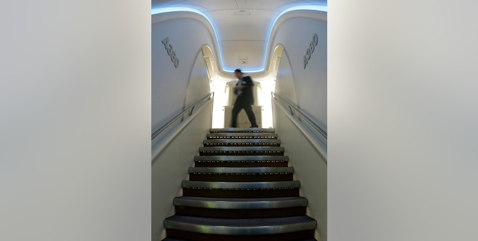 FILE PHOTO: Interior view shows the stairs between two decks in the Airbus A380 at Frankfurt Airport, Germany, March 22, 2007.  REUTERS/Alex Grimm/File Photo