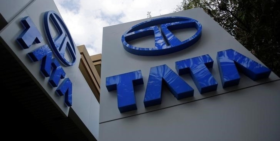 Tata Motors logos are seen at their flagship showroom in Mumbai February 14, 2013.  REUTERS/Vivek Prakash/File Photo