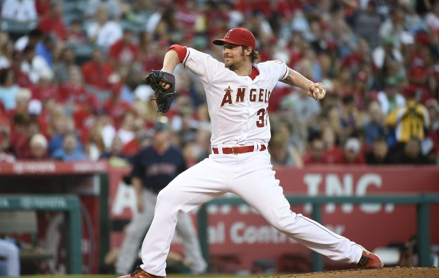 Jul 17, 2015; Anaheim, CA, USA -- Los Angeles Angels starting pitcher C.J. Wilson (33) pitches against the Boston Red Sox during the second inning at Angel Stadium of Anaheim.