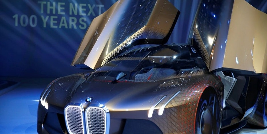 FILE PHOTO: BMW presents the 'Vision Next 100' concept car during centenary celebrations at the Olympic Hall in Munich, southern Germany March 7, 2016.    REUTERS/Michael Dalder/File Photo