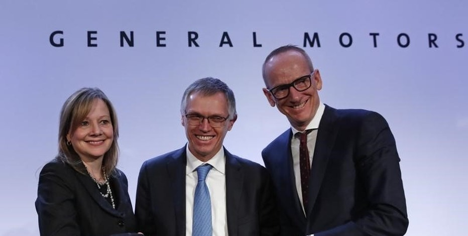 Carlos Tavares (C), Chairman of the Managing Board of French carmaker PSA Group, Mary Barra (L), chairwoman and CEO of General Motors, and Dr Karl-Thomas Neumann, Chairman of the Management Board Opel Group GmbH, pose during a news conference in Paris, France, March 6, 2017.  REUTERS REUTERS/Christian Hartmann