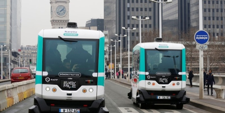 Two self-driving electric minibuses are seen on the 130-metre (142-yard) test route between Gare de Lyon and Austerlitz train stations, the first regular line opened by the Paris transport company RATP, in Paris, France, January 24, 2017. REUTERS/Jacky Naegelen