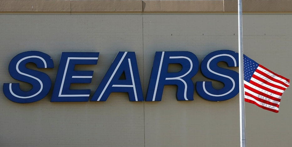 A Sears store sign is pictured in Schaumburg, Illinois near Chicago in this September 23, 2013 file photo. Sears Holdings Corp is closing its downtown Chicago flagship outlet in April, the latest move by the retailer to cut the number of its stores as it relies more on online retailing.    REUTERS/Jim Young/Files    (UNITED STATES - Tags: BUSINESS LOGO)