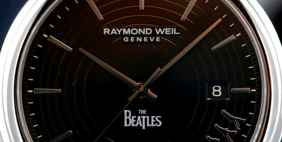 A Raymond Weil Maestro Beatles watch is displayed at the Baselworld Watch and Jewellery Show in Basel, Switzerland March 23, 2017. REUTERS/Arnd Wiegmann