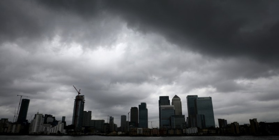 Rain clouds pass over Canary Wharf financial financial district in London, Britain July 1, 2016. REUTERS/Reinhard Krause