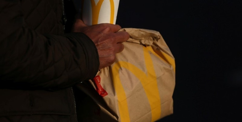 A man carries branded McDonald's purchases in London, Britain December 9, 2016. REUTERS/Neil Hall