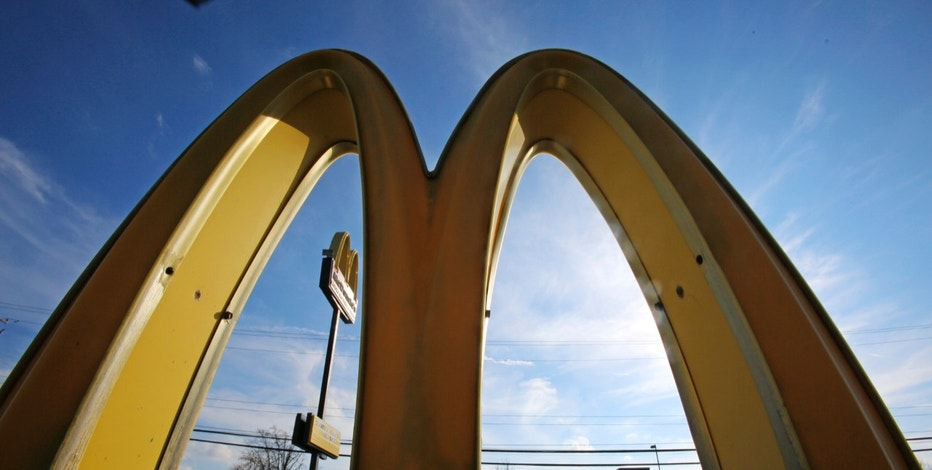 This Wednesday, Feb. 22, 2017, photo, shows the golden arches at sunset at a McDonald's restaurant in Robinson Township, Pa. McDonald's Corp. says it will launch mobile order-and-pay and curbside pickup in the U.S. toward the end of 2017. (AP Photo/Gene J. Puskar)