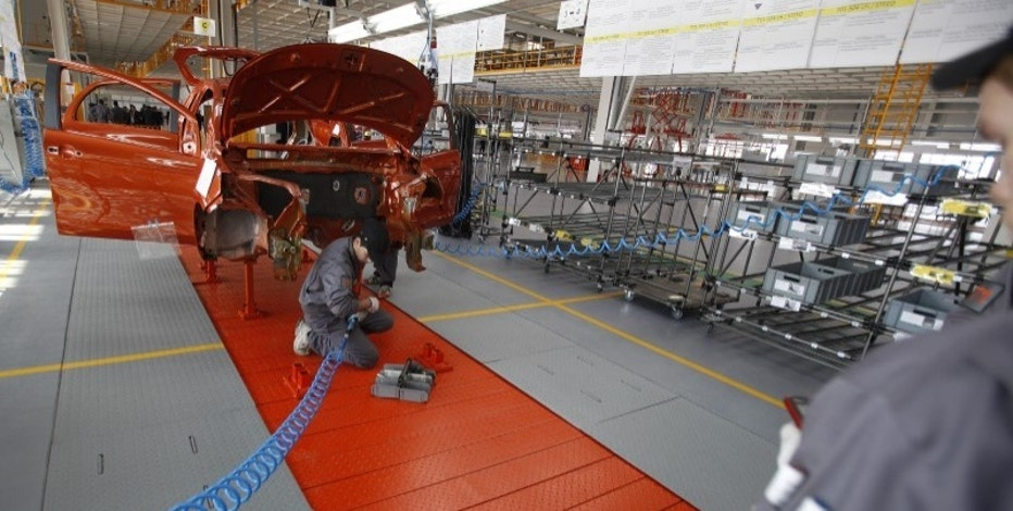 FILE PHOTO: Mechanics work on an assembly line in the car factory of Great Wall Motor Co near the town of Lovech, some 150 km (93 miles) north-east of Sofia February 21, 2012. REUTERS/Stoyan Nenov