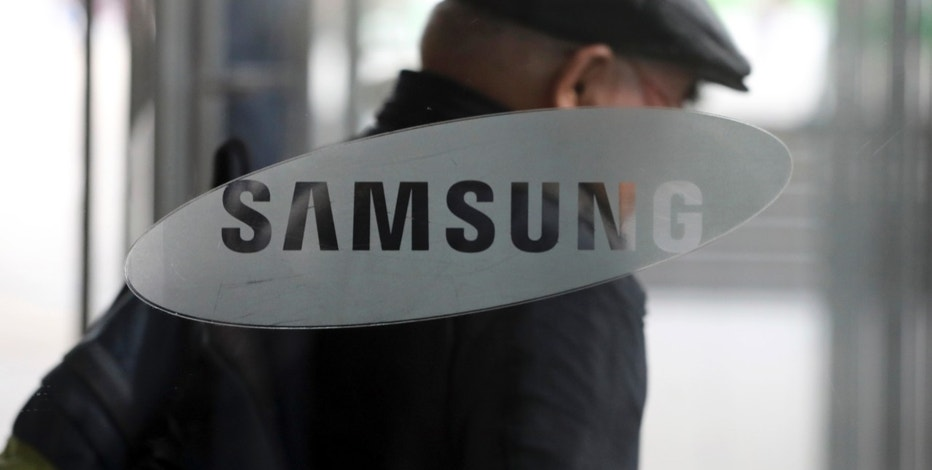 In this March 24, 2017 photo, a man walks past near a logo of Samsung Electronics in Seoul, South Korea. Samsung Electronics said Friday, April 7, 2017 its first-quarter profit jumped 48 percent likely due to smartphone component sales. (AP Photo/Lee Jin-man)