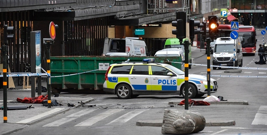 "A concrete traffic stopper called ""Stockholmslejon"" lays on its side outside the cordoned off area next to the department store Ahlens following a suspected terror attack on the Drottninggatan Street in central Stockholm, Sweden, Saturday April 8, 2017. A hijacked beer truck plowed into pedestrians at a central Stockholm department store on Friday, killing several people, wounding many others and sending screaming shoppers fleeing in panic in what Sweden's prime minister called a terrorist attack. A nationwide manhunt was launched and one person was arrested following the latest use of a vehicle as a weapon in Europe. (Jonas Ekstromer/TT News Agency via AP)"