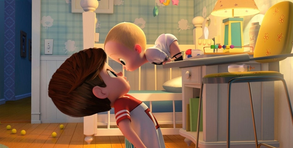 "This image released by DreamWorks Animation shows characters Tim, voiced by Miles Bakshi, left, and Boss Baby, voiced by Alec Baldwin in a scene from the animated film, ""The Boss Baby."" (DreamWorks Animation via AP)"