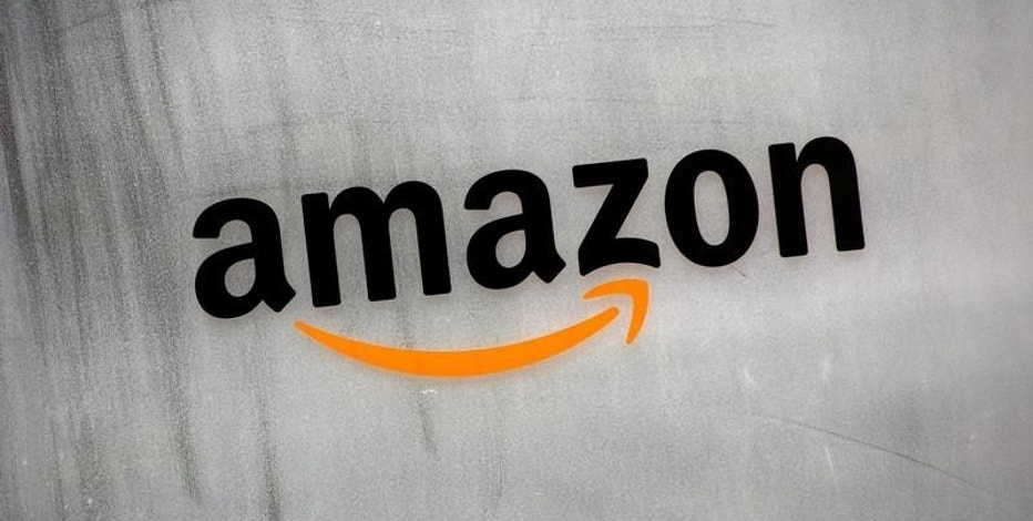 FILE PHOTO: Amazon.com's logo is seen at Amazon Japan's office building in Tokyo, Japan, August 8, 2016. REUTERS/Kim Kyung-Hoon