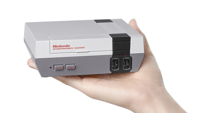 This image provided by Nintendo shows the Nintendo Entertainment System Classic Edition. The NES Classic Edition includes all your childhood favorites, assuming you came of age in the late 1980s or 1990s. If not, think of them as the horribly dated, super-pixellated games you sometimes see in the back of dive bars. (Nintendo via AP)
