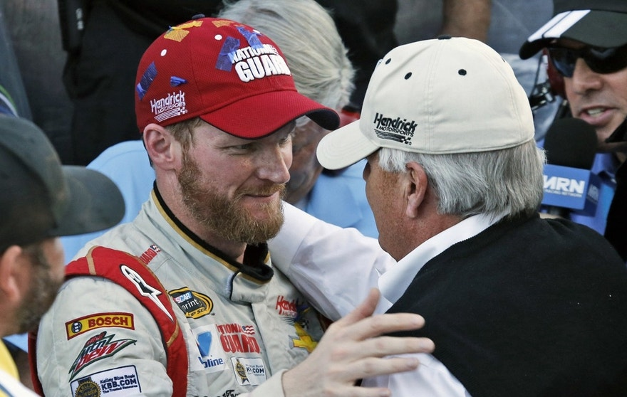 In this Oct. 26, 2014, file photo, Dale Earnhardt Jr. celebrates winning the NASCAR Sprint Cup Series auto race with team owner Rick Hendrick, front right, in Victory Lane at Martinsville Speedway in Martinsville, Va. Hendrick Motorsports says Dale Earnhardt Jr. will retire at the end of this season.