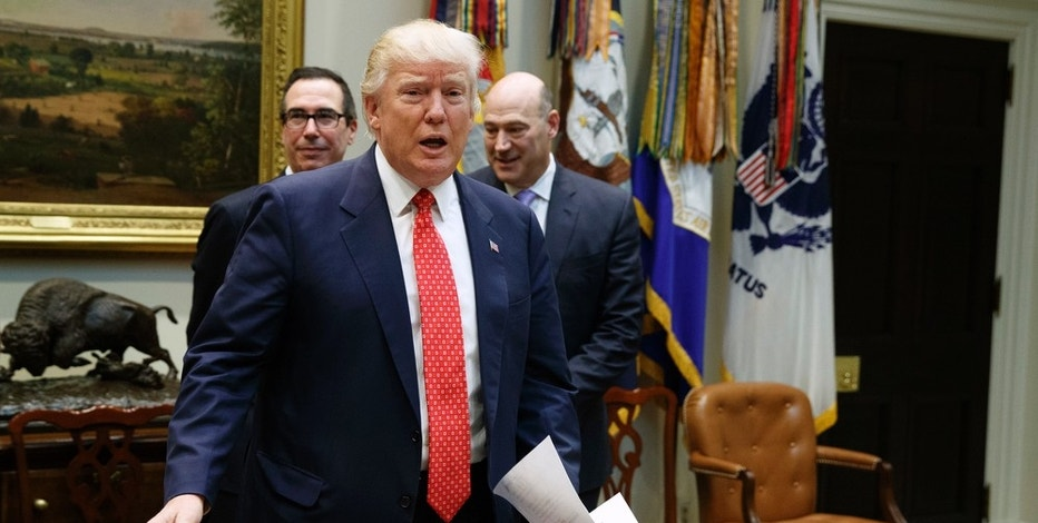President Donald Trump, followed by Treasury Secretary Steven Mnuchin, left, and White House Economic Council Director Gary Cohn arrives for a meeting on the Federal budget, Wednesday, Feb. 22, 2017, in the Roosevelt Room of the White House in Washington.  (AP Photo/Evan Vucci)