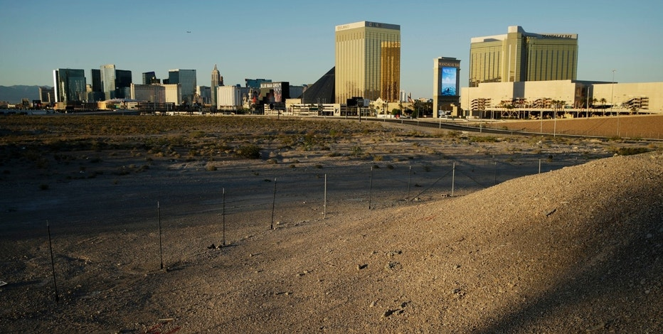 In this May 1, 2017, photo, land purchased by the Oakland Raiders near the Las Vegas Strip where their future home is to be located in Las Vegas, is lit by late-afternoon sunlight. Public records show the team paid $77.5 million for the four parcels in an area close to the Mandalay Bay hotel-casino. (AP Photo/John Locher)