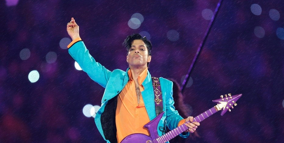FILE - In this Feb. 4, 2007, file photo, Prince performs during the halftime show at the Super Bowl XLI football game at Dolphin Stadium in Miami. Prince's Warner Bros. Records catalog is going to all streaming services. Tidal's exclusive streaming rights ends Sunday, Feb. 12, 2017. Prince had given Tidal the exclusive rights before he died and the streaming service maintained the catalog for months after his death. (AP Photo/Chris O'Meara, File)