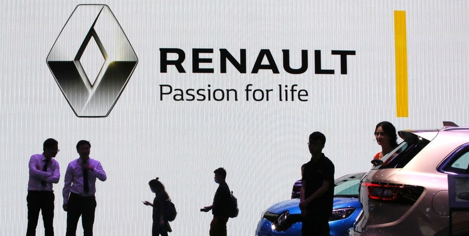 Visitors walk past the Renault stand during the Auto Shanghai 2017 show at the National Exhibition and Convention Center in Shanghai, China, Thursday, April 20, 2017. Models on display at Auto Shanghai 2017, the global industry's biggest marketing event of the year, reflect the conflict between Beijing's ambitions to promote environmentally friendly propulsion and Chinese consumers' love of hulking, fuel-hungry SUVs. (AP Photo/Ng Han Guan)