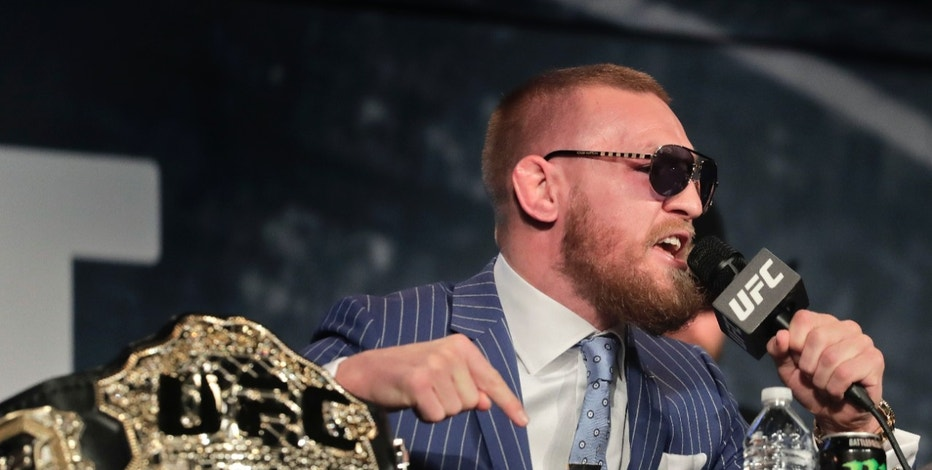 UFC featherweight champion Conor McGregor speaks during a news conference for UFC 205, Tuesday, Sept. 27, 2016, in New York. McGregor will challenge lightweight champion Eddie Alvarez for the lightweight belt on Nov. 12 in what will be the first UFC card to be held in New York after the state legislature legalized the sport earlier this year. (AP Photo/Julie Jacobson)