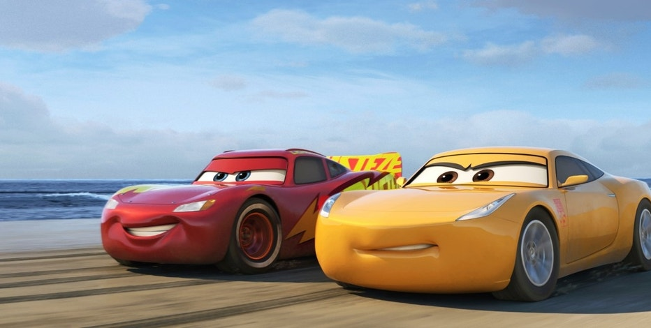 "This image released by Disney shows Lightning McQueen, voiced by Owen Wilson, left, and Cruz Ramirez, voiced by Cristela Alonzo in a scene from ""Cars 3."" (Disney-Pixar via AP)"
