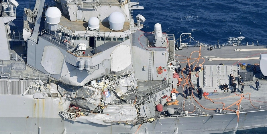 The damage of the right side of the USS Fitzgerald is seen off Shimoda, Shizuoka prefecture, Japan, after the Navy destroyer collided with a merchant ship, Saturday,  June 17, 2017.  The U.S. Navy says the USS Fitzgerald suffered damage below the water line on its starboard side after it collided with a Philippine-flagged merchant ship.  (Iori Sagisawa/Kyodo News via AP)